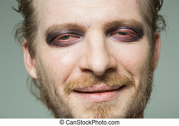 portrait of a man with hooded eyes.