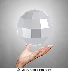 Abstract low poly 3d sphere on background - hand showing...