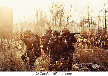 soldiers with guns on the field - rangers with a rifle...