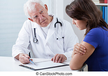 Doctor doing medical interview - Practiced doctor doing...