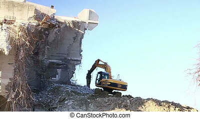 Excavators work - Excavator working on the destruction of...