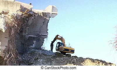 Excavators work - Excavator working on the destruction of...