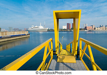 yellow gangway of a ship in the port of rotterdam