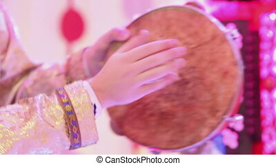 Playing on tambourine