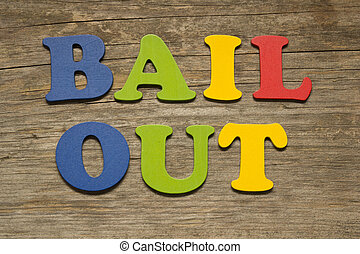 Bail out text on a wooden background