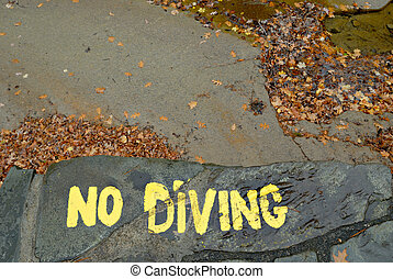 No Diving - Warning sign painted on empty swimming hold