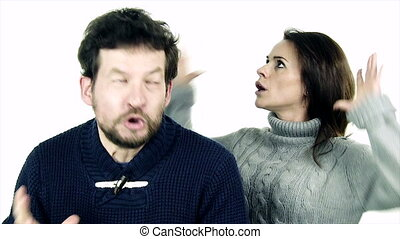 Man shouting angry with woman