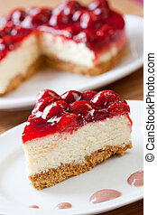 Slice of delicious strawberry cheese cake with a cake in the...