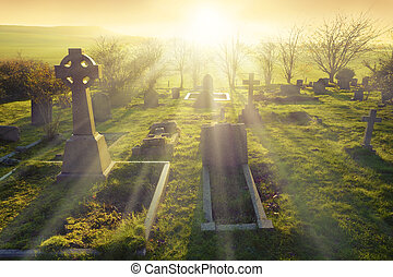 Afterlife - Heavenly light shining upon a old graveyard in...