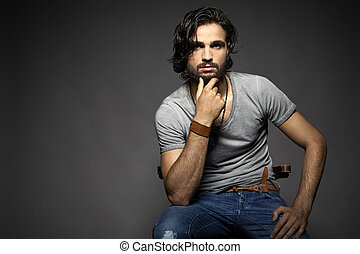 Portrait of handsome young man against grey background