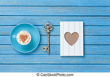 Cappuccino, key and photo frame - Cup of Cappuccino with...