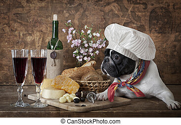 French bulldog in chefs hat lying on the table with cheese...