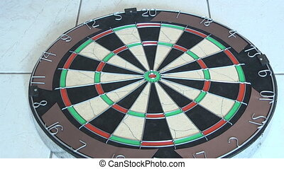 darts being thrown into dart board