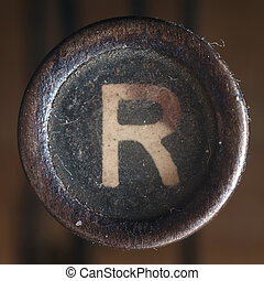 Letter R - Details of a dusty old letter, closeup of vintage...