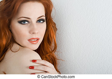 Sensuality - Beautiful redhead young woman with blue eyes