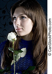Mistery - Beautiful young woman with white rose