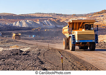 Open mining pit  - Open coal mining pit with heavy machinery