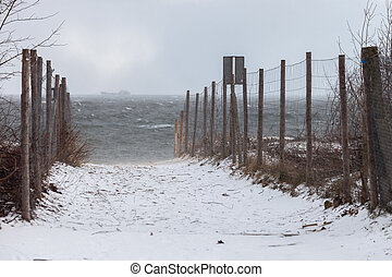 Beach in a blizzard - Entrance to the beach in a winter...