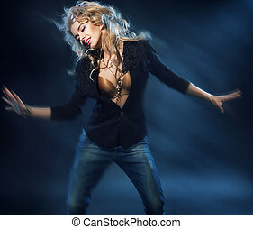 Blonde attractive woman on the dance floor - Blonde...