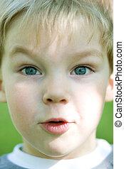 Surptise - Amazed little kid closeup Outdoor shot