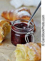 Croissants with cherry jam