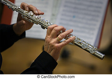 Flutists Woman with nodes - Flutists woman close up playing...