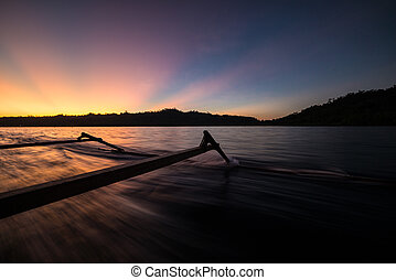 Traditional boat riding at sunset
