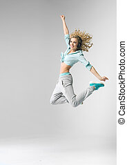 Blond athlete dancing and jumping - Young blond athlete...