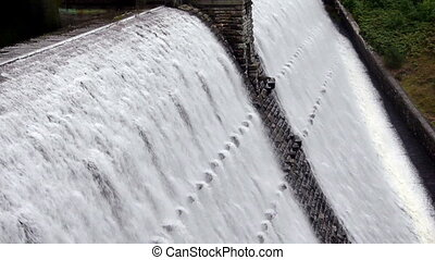 Water flowing at high speed from Elan Valley dam (with...
