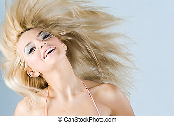 Funny girl - Beautiful funny girl with flying blond hair