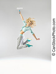 Jumping woman with a paint roller - Jumping lady with a...