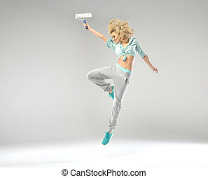 Fabulous shapely girl jumping with paint roller - Fabulous...