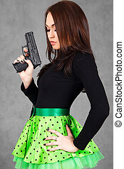 Portrait of a young attractive woman in a bright green skirt...