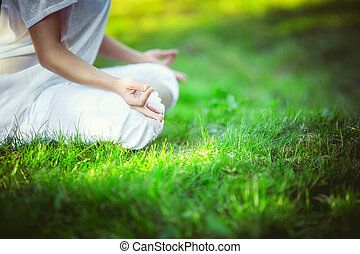 Body part - Woman in lotus pose outdoors