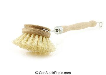 wooden dish washing brush on a white background