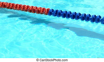 Swimming pool with rippled surface HD footge.