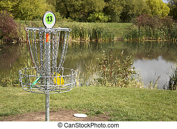 Frisbee Golf Target - A frisbee golf target with discs in...