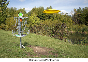 Frisbee Golf With Disc - Frisbee golf disc being thrown at...