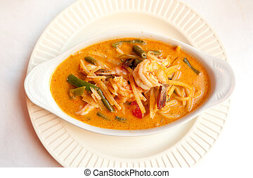 Red curry dish with chicken in Thai restaurant