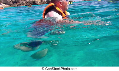 Snorkeling - Middle-aged man at the snorkeling near Ko Miang...