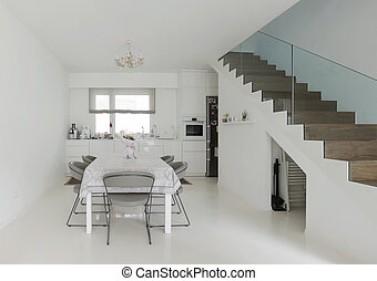 kitchen and dining room - white kitchen and dining room with...