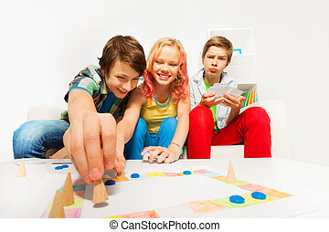 Happy teenagers play table game together at home - Happy...