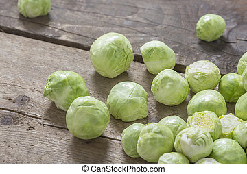 Brussels sprouts on wood - Brussels sprouts on a rustic...