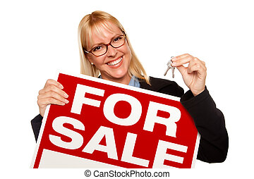 Attractive Blonde Holding Keys & For Sale Sign Isolated on a...