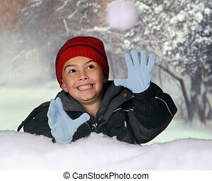 Snowball Catcher - A happy kindergarten boy catching a...