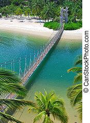 Wooden suspension bridge to paradise
