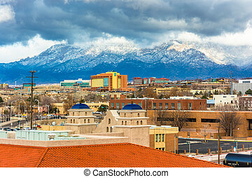 View of distant mountains and buildings in Albuquerque, New...