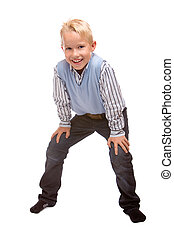 Young child is laughing and stands casual, isolated on white background