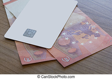 Credit or Debit Card on Euro Notes - A Blank white Credit or...