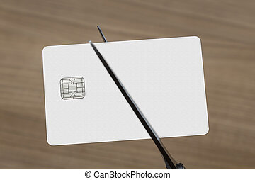 scissors cutting a credit or debit card - scissors cutting a...